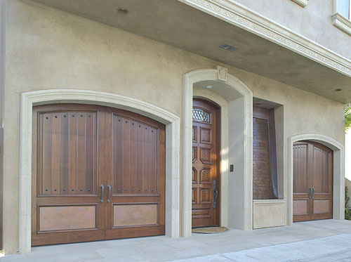 aaagate.com gate designs - wood and iron garage door carriage house style.
